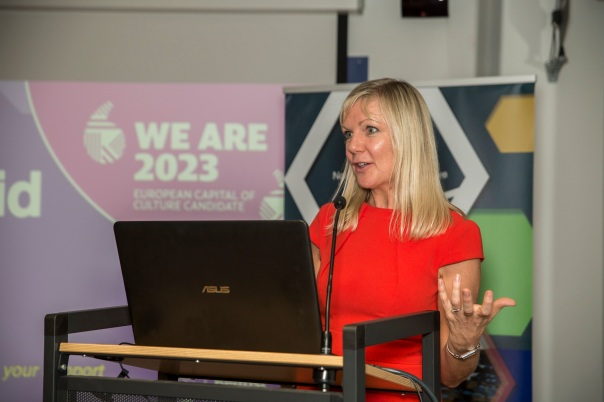 Suzanne Wylie standing at a podium addressing the guests